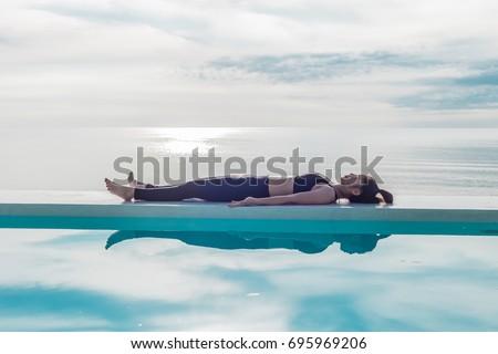 asian woman relaxing yoga savasana pose stock photo