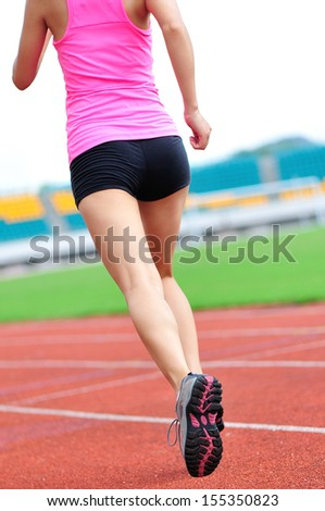 asian woman runner running in the playground outdoor