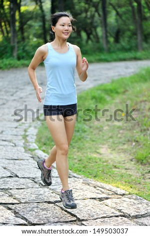 asian woman runner running outdoor in the morning