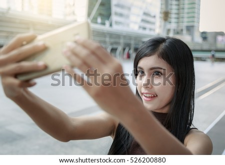 Asian Woman Selfie In The City Alone