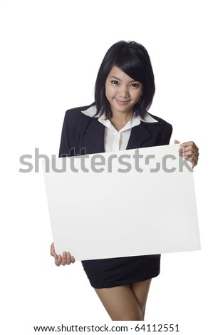 Asian woman showing and holding a blank billboard sign banner - stock photo