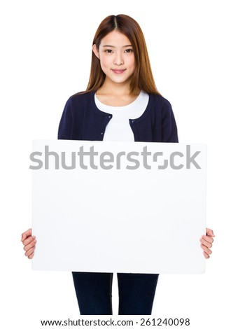 Asian woman showing banner - stock photo