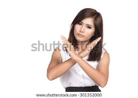 Asian woman showing denial with NO on her hand with blank copy space,Portrait of beautiful Asian woman, Thai girl, Negative human emotion expression, isolated on white background