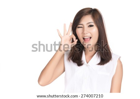 Asian woman showing OK sign  with blank copyspace area for text or slogan,Closeup portrait of beautiful Asian woman,Thai girl,Positive human emotion facial expression,isolated on white background - stock photo