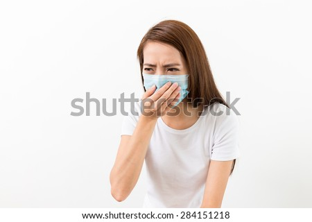 Asian woman sneeze with mask - stock photo