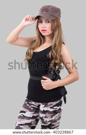 asian woman soldier in black military clothes with her gun