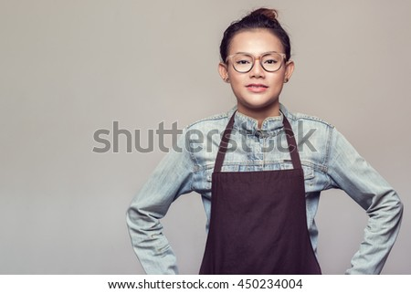 Asian woman standing with determination.