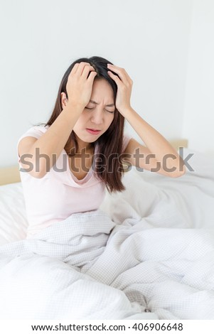 Asian woman suffer from headache - stock photo