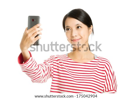 Asian woman take photo by herself - stock photo
