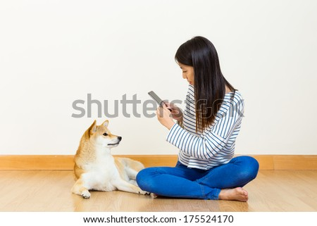 Asian woman take photo with her lovely dog - stock photo