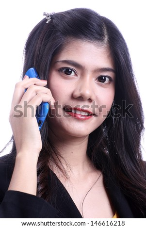 Asian woman talking mobile phone