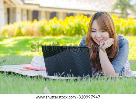 Asian Woman Use Laptop in the park
