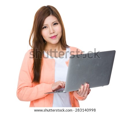 Asian woman use of notebook computer - stock photo