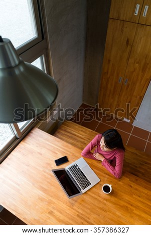 Asian woman use of the laptop computer at home
