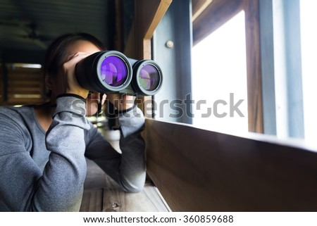 Asian woman use of the telescope at indoor - stock photo