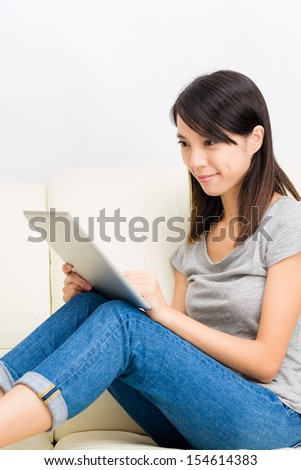 Asian woman use tablet computer at home