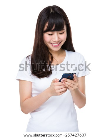 Asian woman uses cellphone