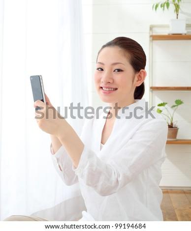 asian woman using cellphone - stock photo
