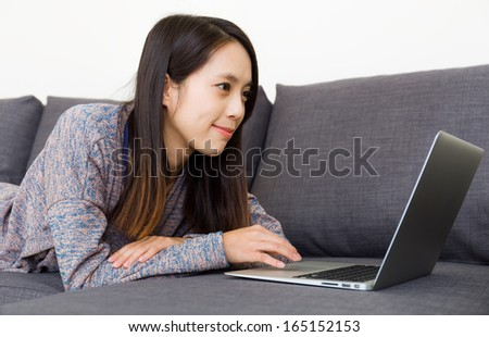 Asian woman using computer at home