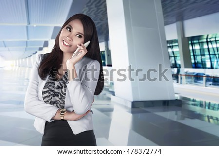 Asian woman using smartphone and call with someone and she have fun with her phone