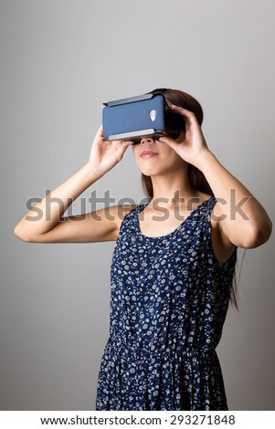 Asian woman using the VR device - stock photo