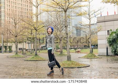 Asian woman walk at street after raining in Taipei, Taiwan,  Asia. - stock photo