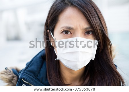 Asian Woman wear medical mask - stock photo