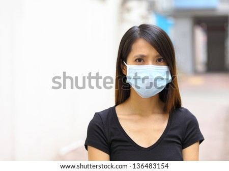 Asian woman wear protective face mask - stock photo