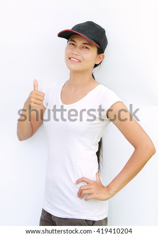 Asian woman wear T-Shirt and cap showing thumb up on white background