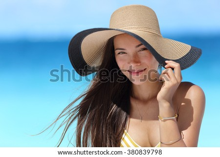 Asian woman wearing fashion straw beach hat for skin care sun protection. Face skincare beauty concept. Beautiful Chinese Caucasian mixed race young adult girl portrait on summer vacation travel. - stock photo