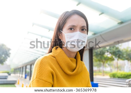 Asian woman wearing the face mask - stock photo