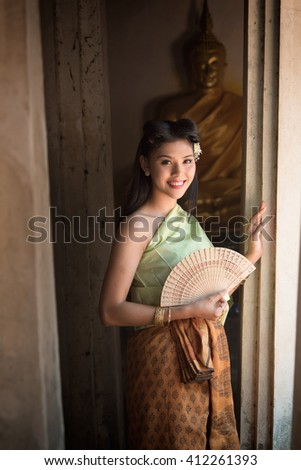 Asian woman wearing typical Thai dress.