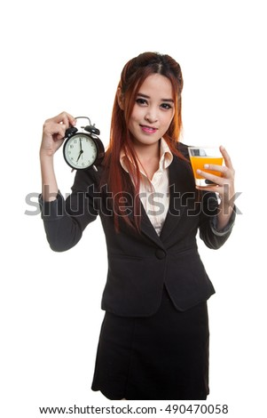 Asian woman with a clock drink orange juice  isolated on white background.
