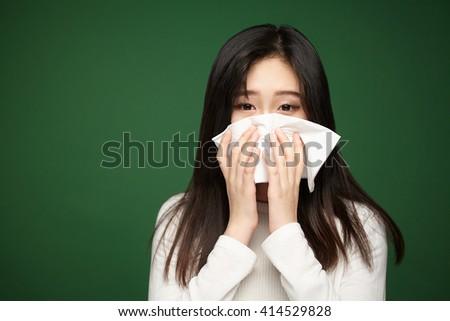 asian woman with a flu, sneezing closeup  - stock photo