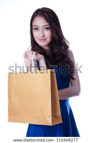 Asian woman with a shopping bag on hand