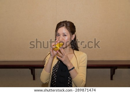 Asian woman with alcohol - stock photo