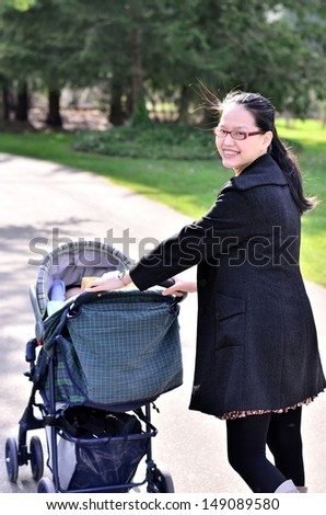 Asian woman with baby stroller