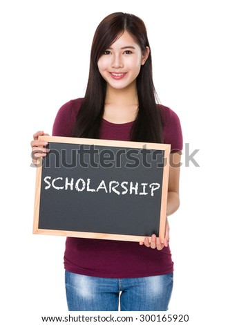 Asian woman with chalkboard showing a word scholarship