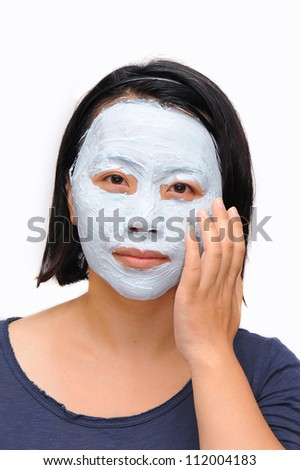 Asian woman with cosmetic mask on her face