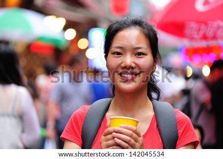asian woman with cup of drink at street - stock photo