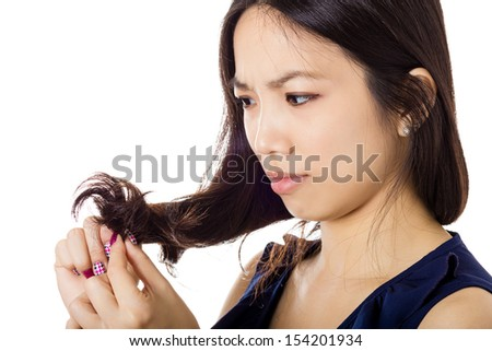 Asian woman with hair problem - stock photo