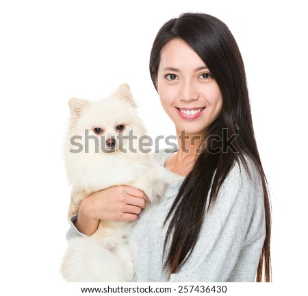 Asian woman with her puppy - stock photo