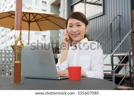 asian woman with laptop