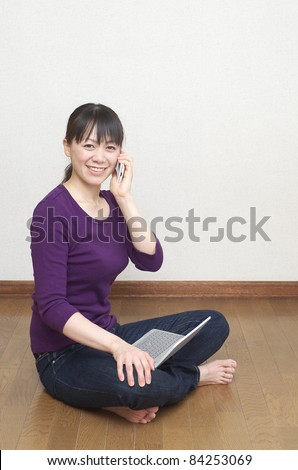 Asian woman with laptop computer - stock photo