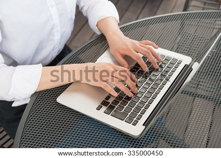 asian woman with laptop outdoors