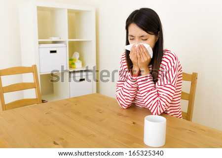 Asian woman with nose allergy - stock photo