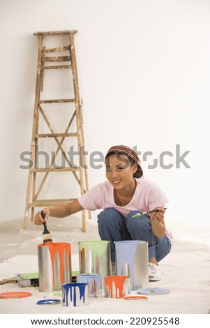 Asian woman with painting supplies - stock photo