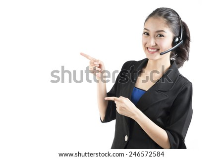 asian woman with pointing finger isolated over white - stock photo