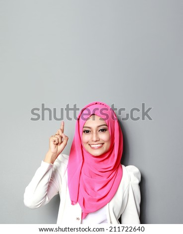 asian woman with scarf presenting copyspace - stock photo