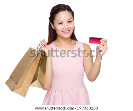 Asian woman with shopping bag and credit card